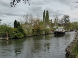 A boat passing though Sonning Lock.