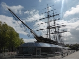 Cutty Sark, surrounded by barriers for the London Marathon.